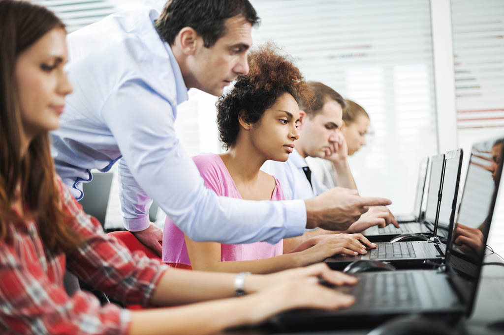 Assistance at computer class. - West Islip Public Library